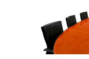 seats at a conference table for a board